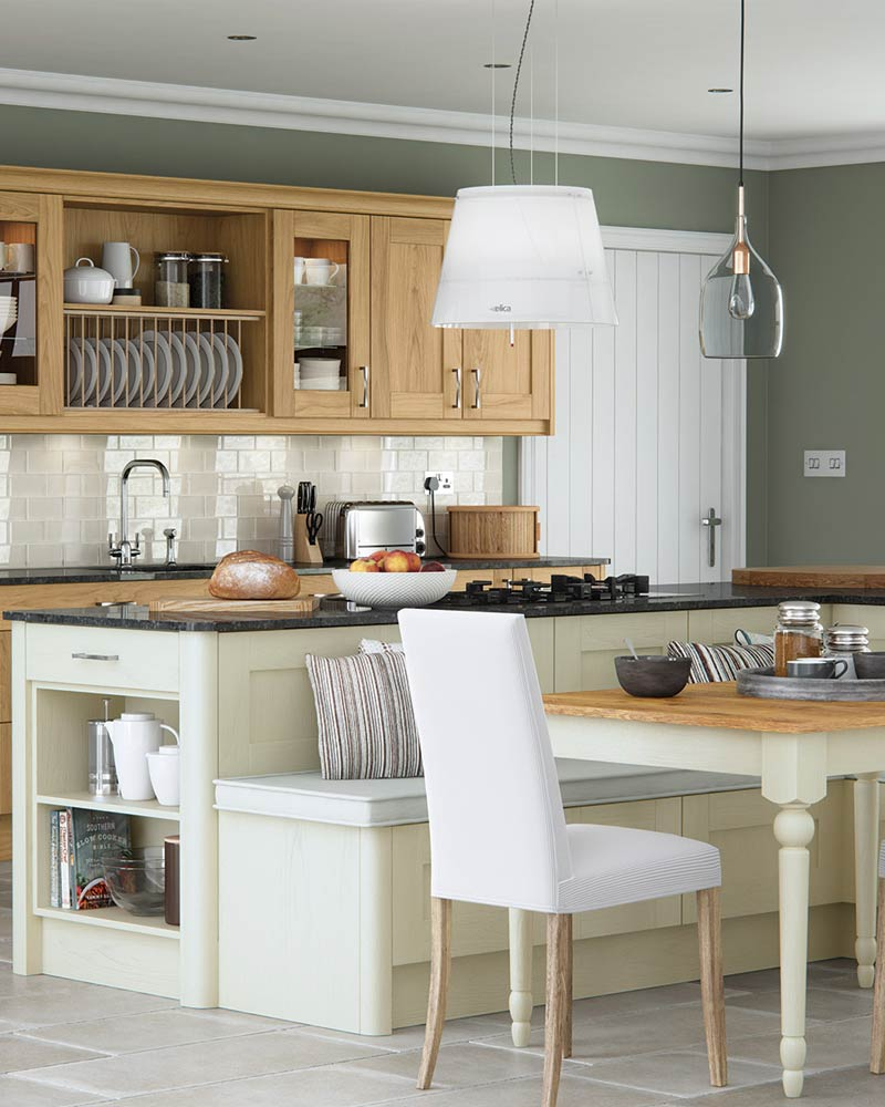 Contemporary Kitchens Liverpool, with oak base and wall cabinets and a cream island with granite top. Combining both traditional and modern styles to create a contemporary kitchen.