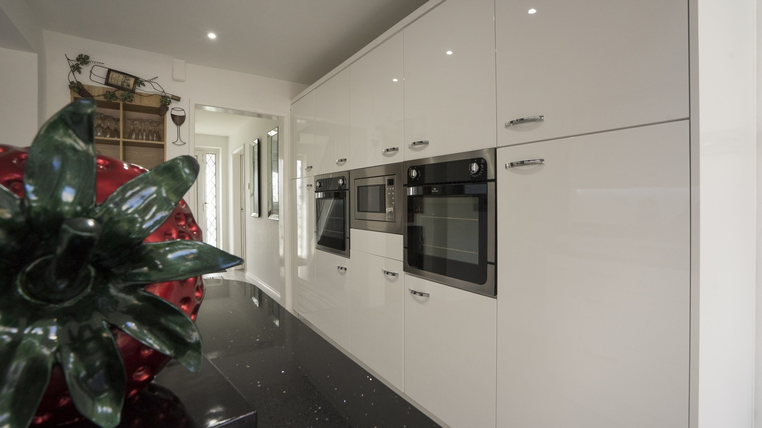 Floor to ceiling feature cupboards with integrated appliances, Kirkby Liverpool.