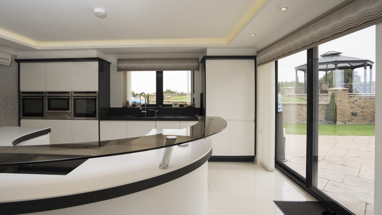 Another view of the kitchen highlighting the large sliding door giving great views of the outside space and a great flow between the in and outdoors when required.
