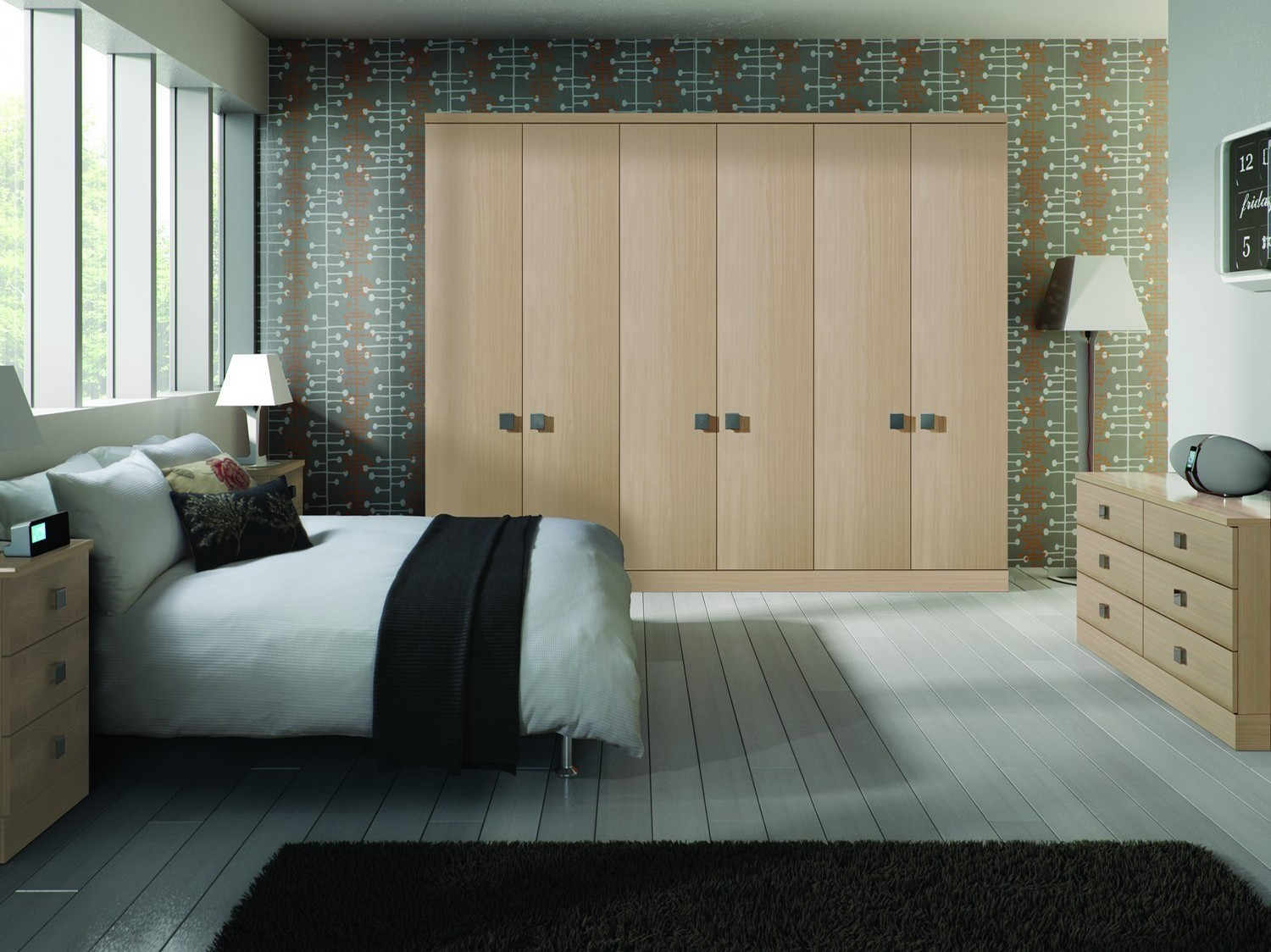 Oak style fitted bedrooms furniture Liverpool designed for our client in Liverpool city centre, including three double wardrobes, a large set of Chester draws and a bedside cabinet. Fitted with a large square chrome handle selected by our client (all of our fitted bedroom furniture can be supplied with a range of handles).