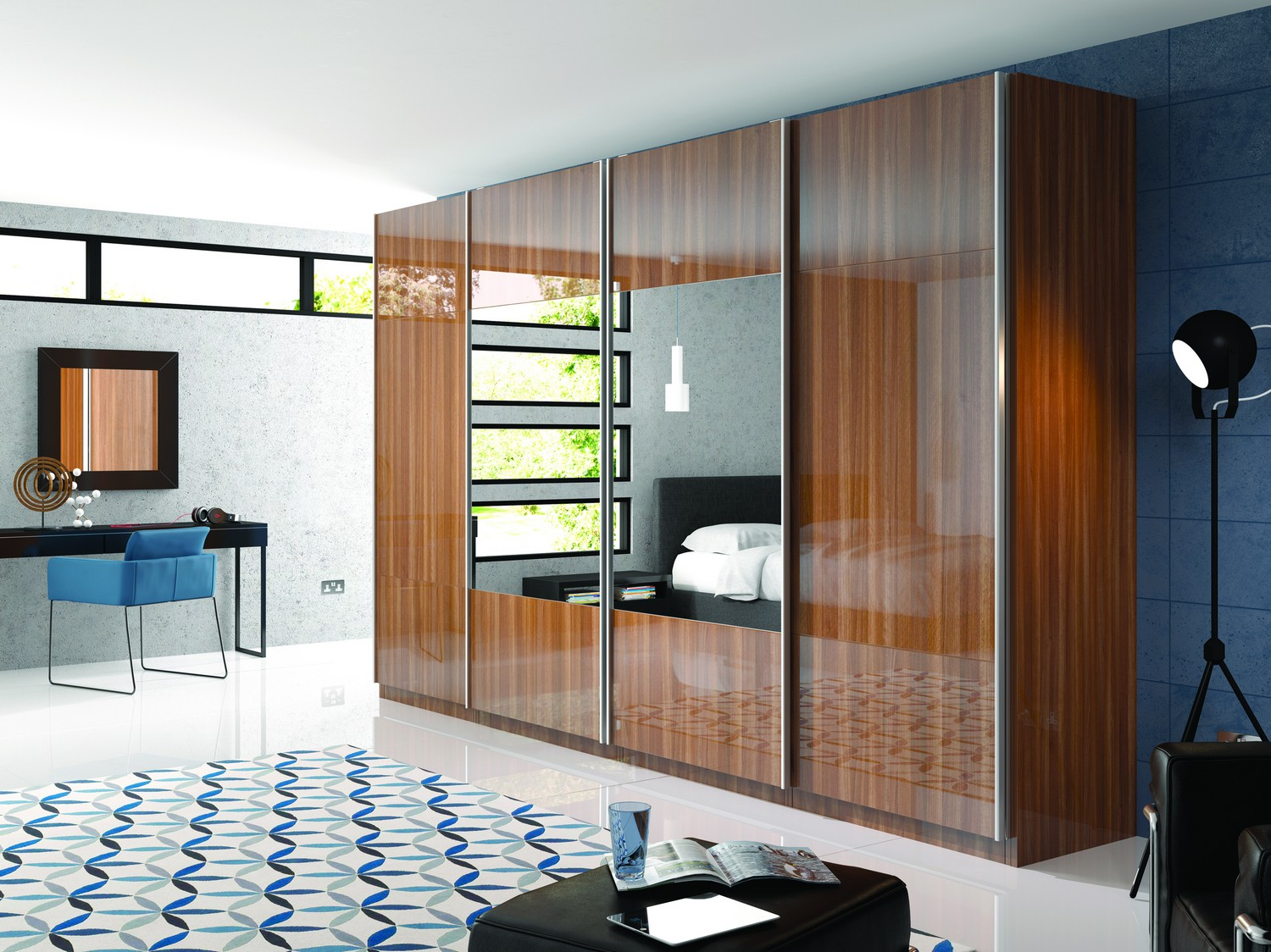 Gloss walnut sliding door wardrobe system with mirrored glass panels featuring a unique internal storage system.