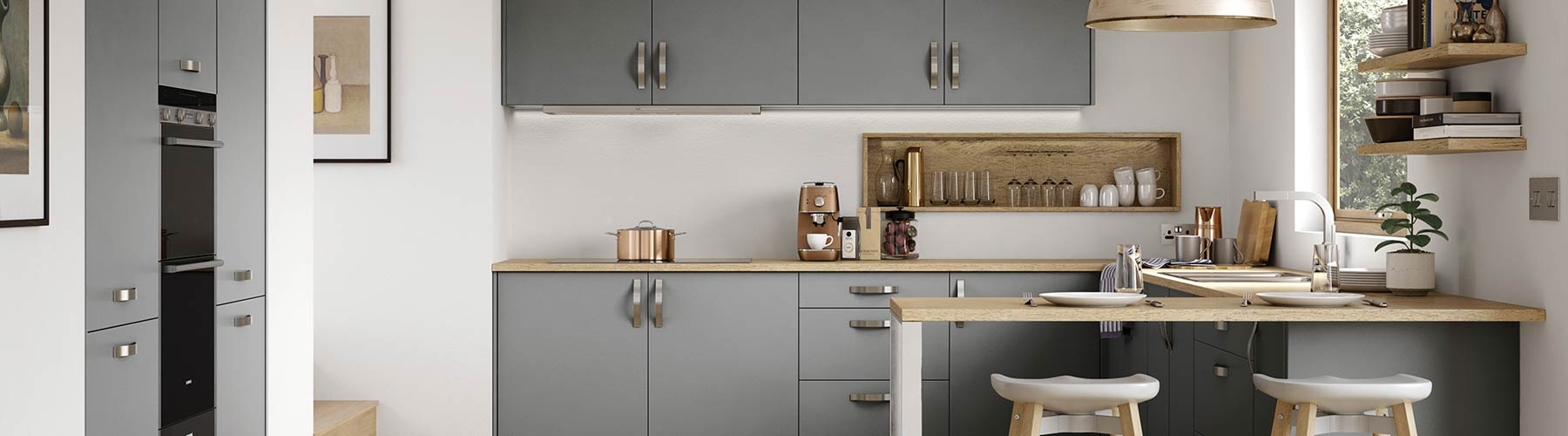 Matt slab grey contemporary kitchen with timber worktops.
