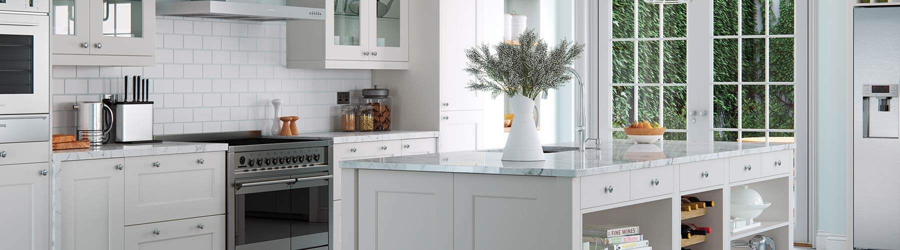 Stunning light grey kitchen with marble grained worktops and chrome hardware.