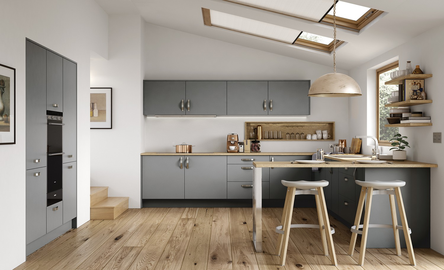 A simple grey slab door with a unique double height oven and large stainless-steel handles have been used here to create a quirky kitchen for our client's new rear extension in Kirkby, Liverpool. The kitchen doors have a matt finish combined with a wooden worktop achieve a modern edgy look. The kitchen worktops have been extended past the lower cupboards to give a seating area ideal for serving food and entertaining company while cooking. The ceramic cooking hob has been integrated into the worktop and the extraction fan has been hidden within the cupboard above.