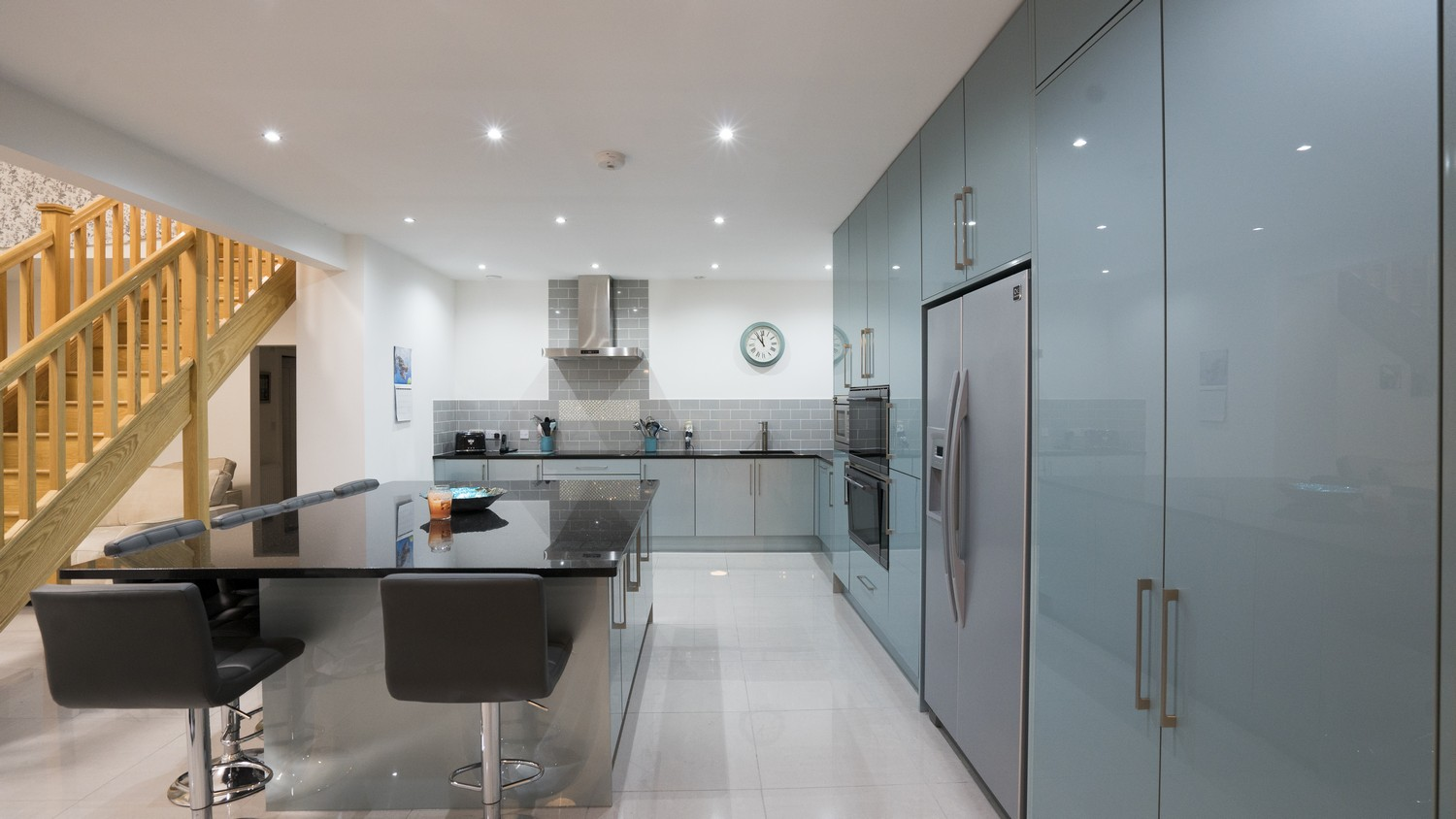 Straight on view of this large kitchen highlighting the open plan living space this kitchen leads on to.