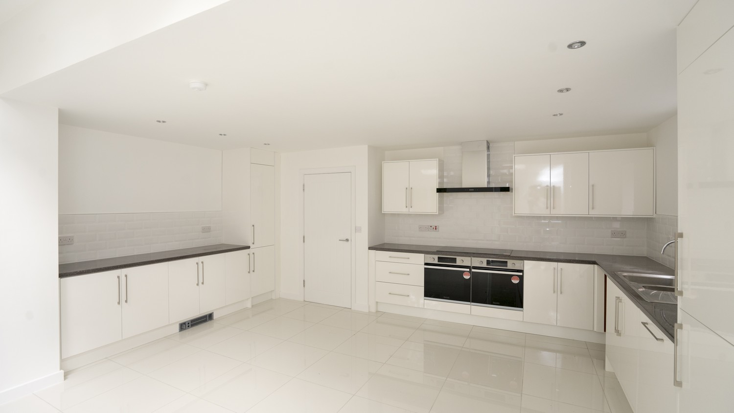 Alternative view of the gloss white kitchen installed in Liverpool, giving the space and bright and open feel.