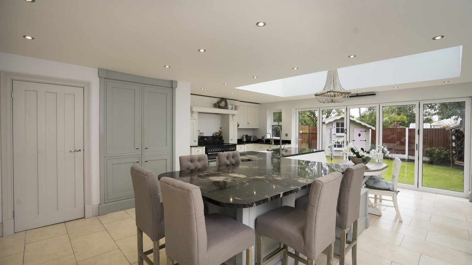 Full overview of this stunning open plan kitchen with roof lantern and bi-folding doors. This kitchen maximises on light, seating, space and all the modern appliance.