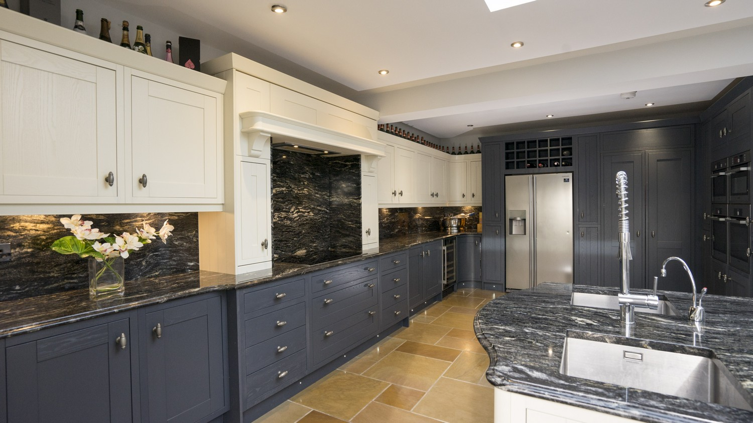 Alternative angle showing the feature wall of cupboards housing the multiple Simens oven and a range of different storage solutions. This kitchen features a various built in appliances Liverpool.