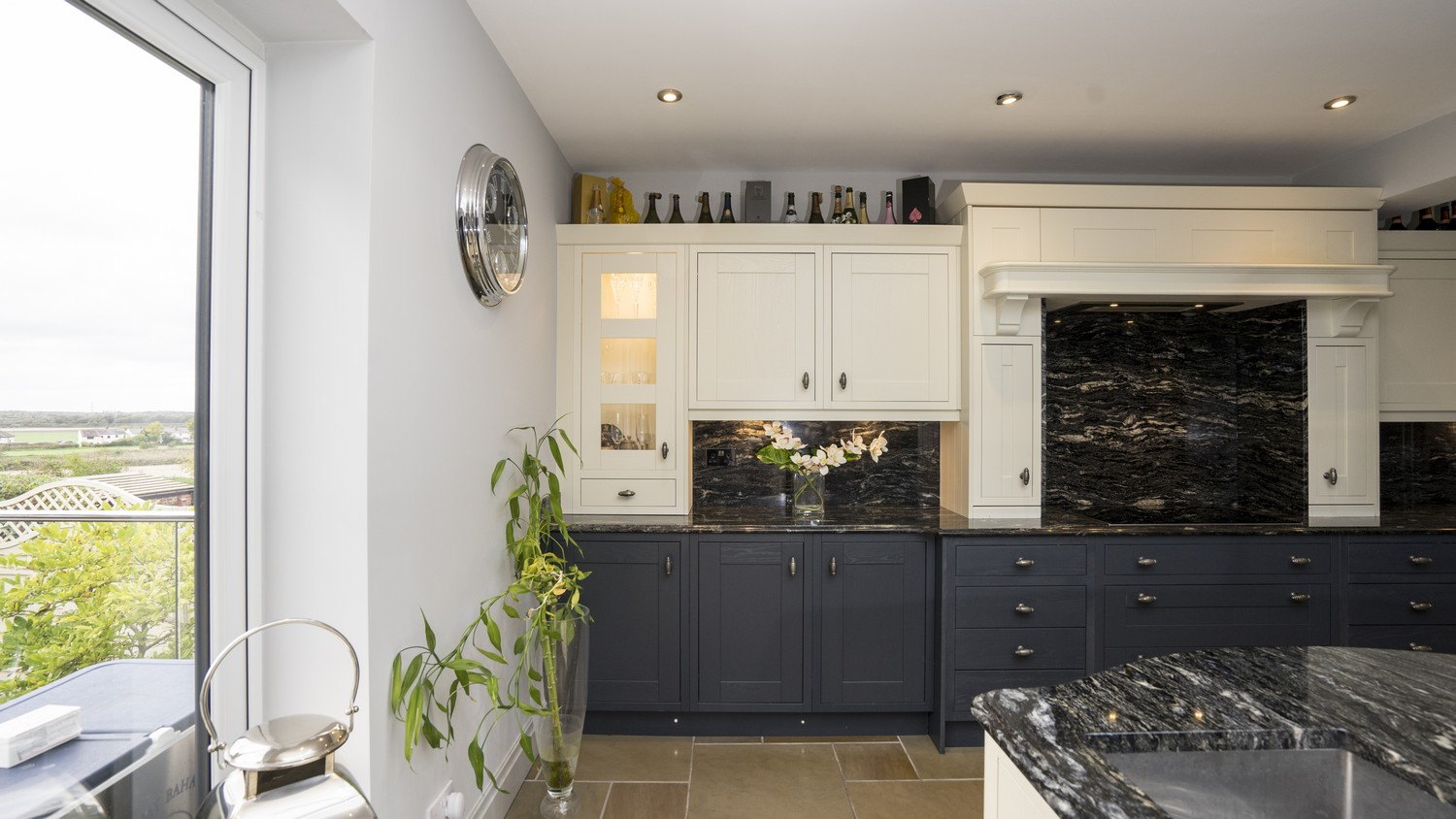 Alternative shot highlighting the cupboard lighting detail and view through the bifolding door to the garden. What a stunning Ormskirk kitchen this is.