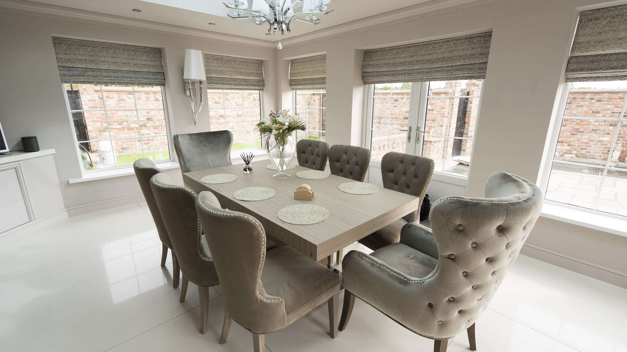 Custom dining table with button backed chairs in Liverpool kitchen.
