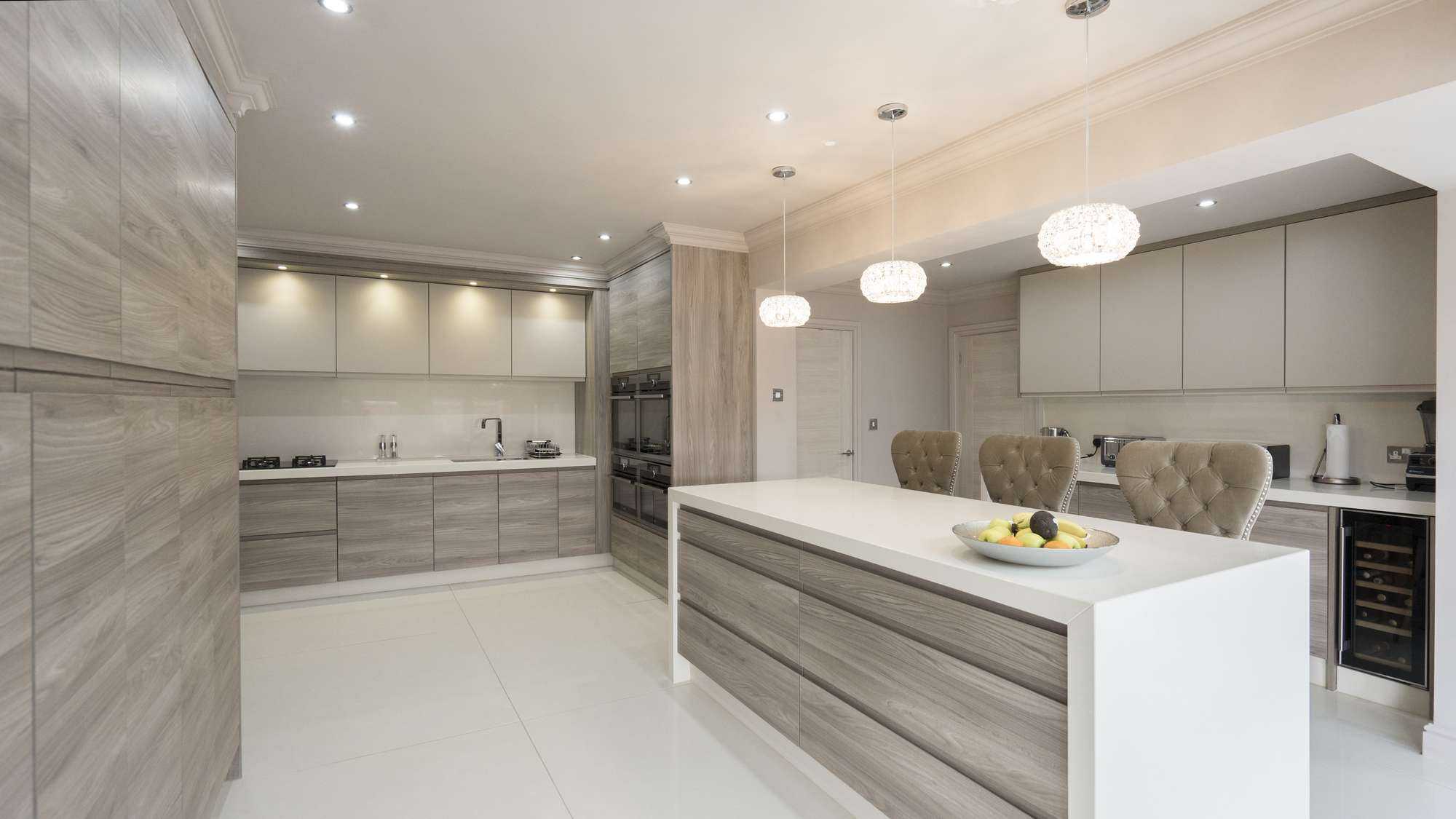 Large kitchen island with up and over granite worktops and button backed stools.