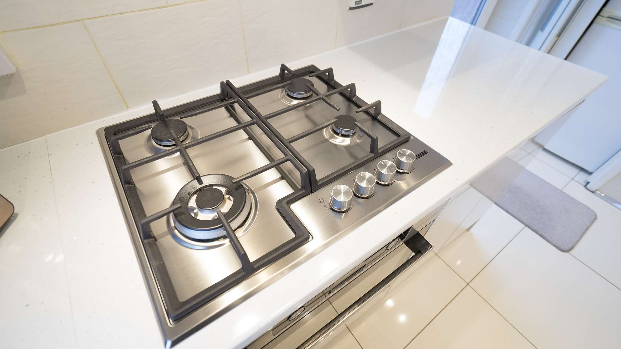 Close up of the 4 burner hob in stainless steel.