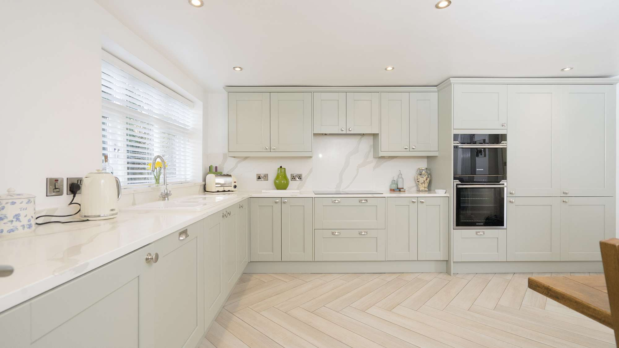 Alternative view of this shaker kitchen, all appliances are integrated and therefore mostly hidden from sight apart from the ovens which can be seen.