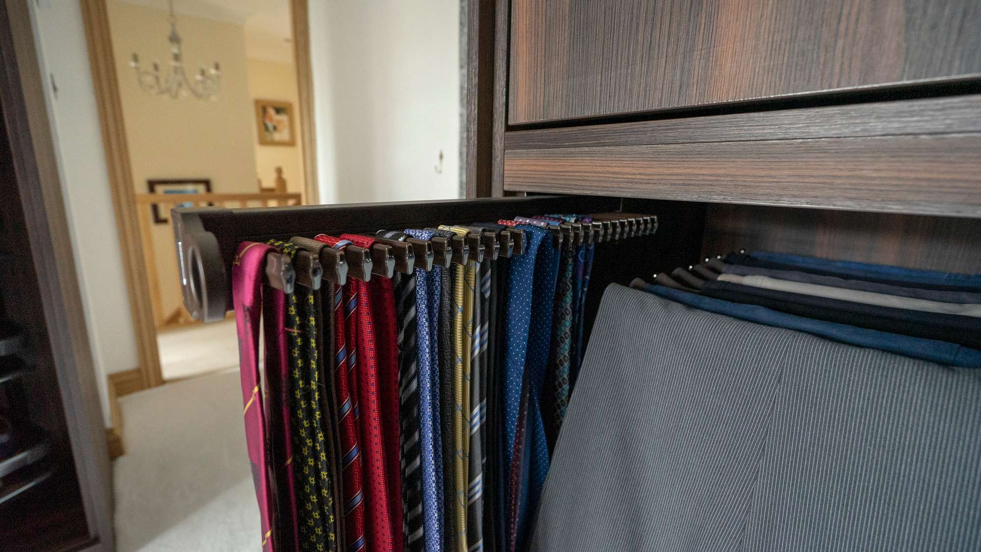 Close up shot of the pull out tie racks.